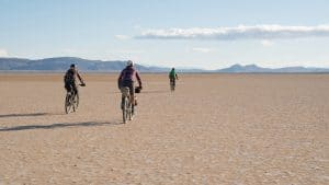 Cyclists on the Alvord Desert