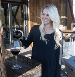 Woman pouring glass of red wine